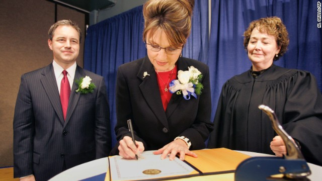 Sarah Palin signs her oath of office document as Lt. Gov. Sean Parnell, left, and Superior Court Judge Niesje Steinkruger look on after her swearing-in ceremony in Fairbanks in December 2006.