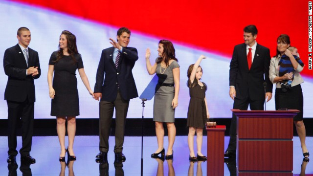 Sarah Palin's family, from left to right, son Track; daughter Bristol; Bristol's then-fiancee Levi Johnston; daughter Willow; daughter Piper; husband Todd and infant Trig, on stage after her speech to the Republican National Convention in September 2008.