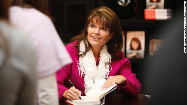 "Sarah Palin signs copies of her second book ""American by Heart"" at Dillon's Marketplace in Andover, Kansas, in November 2010."