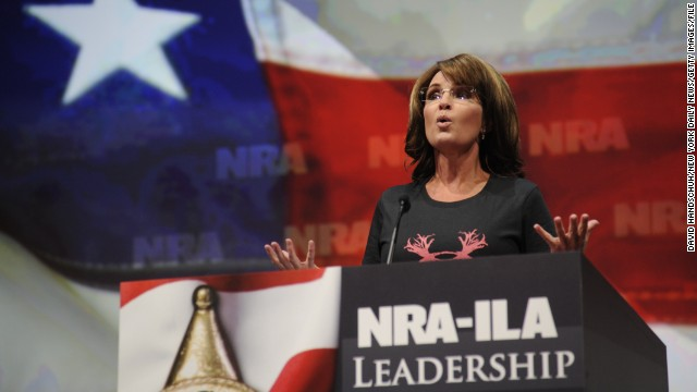 "Wearing a shirt that reads ""Women hunt,"" Sarah Palin blasts President Barack Obama and gun control advocates for ""exploiting"" recent mass shootings as she speaks to the National Rifle Association Convention in Houston in May 2013."