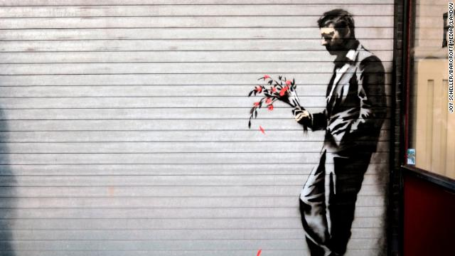 A Banksy piece covers the main entrance to Larry Flynt's Hustler Club in New York's Hell's Kitchen on October 24.