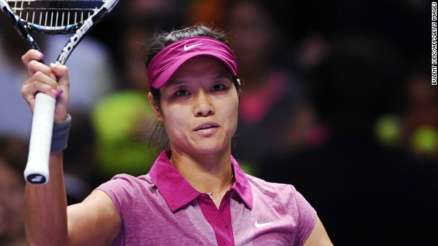 A subdued Li Na acknowledges the Istanbul crowd after becoming the first Chinese player to reach the semifinals of the WTA Championships.