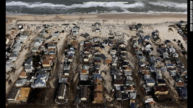 Homes in Seaside Heights, New Jersey, are surrounded by sand and debris on October 31, 2012.