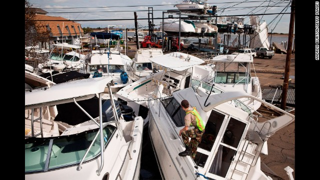 A volunteer surveys boats piled up by Superstorm Sandy on November 1, 2012 in Highlands, New Jersey.