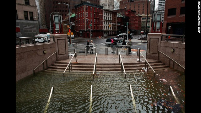 Water floods the Plaza Shops in New York City on October 30, 2012.