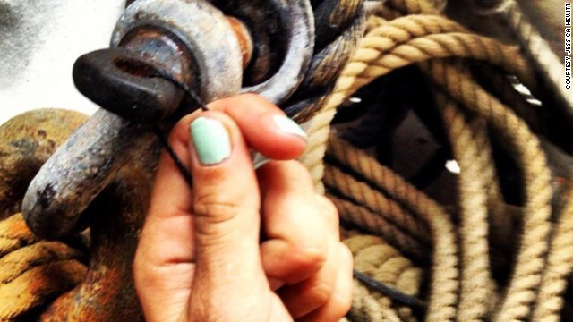 "Hewitt nearly drowned because her tether to a shipmate got caught on sinking debris. She posted this Facebook photo of herself holding twine and ship's rigging. She captioned it, ""Strong like seine twine."" ""It's hard when people say cruel things,"" Hewitt said, ""like 'oh, Bounty, those reckless people' or 'they're loving the attention they get.' They don't see the side like when I had to interrupt my job conducting boat tours to go cry in a Porta-Potty."""