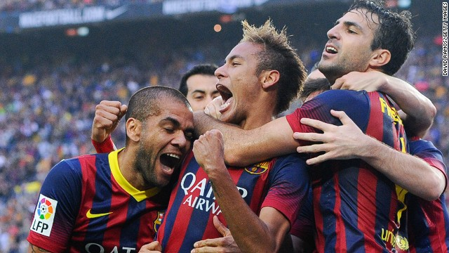 Neymar (center) celebrates scoring Barcelona's opening goal against Real Madrid at the Nou Camp.