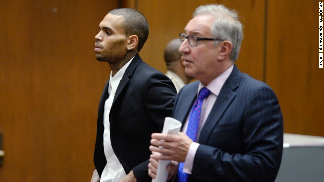Brown, left, appears in court with his attorney Mark Geragos for a probation violation hearing in Los Angeles on August 16.