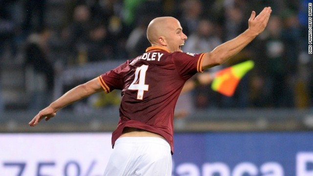 Michael Bradley celebrates his 82nd minute winner to give AS Roma a ninth straight Serie A win.