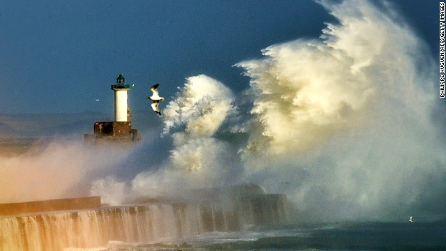 Large waves break against the dyke Monday at the port of Boulogne, France.