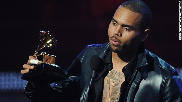 "<strong>February 2012: </strong><a href='http://www.cnn.com/2012/03/29/showbiz/chris-brown-probe/index.html'>A woman filed a police complaint against Brown</a>, accusing him of grabbing her iPhone after she used it to take a photo of the singer in a car on a Miami street on February 19. The complaint prompted a police investigation that could have threatened Brown's probation, but no charge was ever filed. That same month, his album ""F.A.M.E."" won a Grammy for best R&B album."