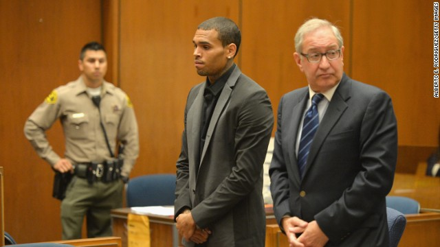 "<strong>July 2013:</strong> <a href='http://www.cnn.com/2013/08/15/showbiz/chris-brown-court/index.html'>Brown's probation was revoked July 15</a> after he was accused of hit-and-run driving and driving without a license. A woman told investigators Brown ""went ballistic"" after a traffic accident and screamed at her. The charges were dropped after Brown reached a ""civil compromise"" with his accuser a month later. Here, he appears in court with his attorney, Mark Geragos."