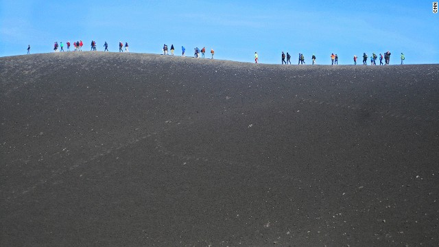 It's possible to hike up Etna. But guided trips to the ridge of the crater -- which include cable car, 4x4 bus and a short guided walk -- take about two hours total.
