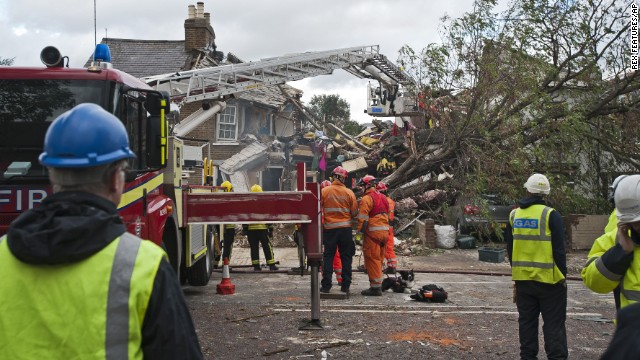 Emergency crews in London clear the wreckage of a house after a fallen tree caused a gas explosion there Monday, October 28. A major Atlantic storm brought wind gusts close to 100 mph Monday, knocking out power to thousands and disrupting travel in England, France, Belgium and the Netherlands.