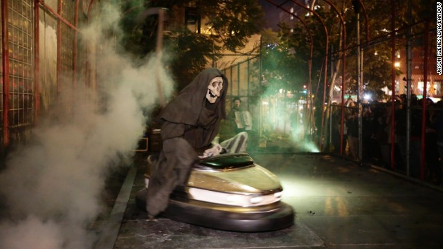 "Banksy's art exhibit ""Grim Reaper Bumper Car"" sits on New York's Lower East Side on Friday, October 25. The famously anonymous artist, whose paintings regularly go for six figures at auction houses around the world, has said he is on a ""residency on the streets of New York."""