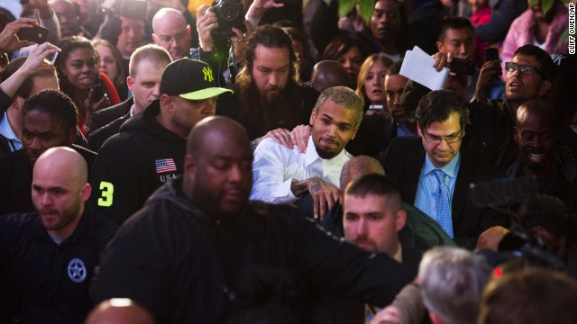 "<strong>October 2013:</strong> <a href='http://www.cnn.com/2013/10/28/showbiz/chris-brown-assault-charge/index.html'>Brown and a bodyguard were accused of assaulting a man</a> on a Washington sidewalk on October 27. The man told police he tried to jump into a photo that Brown was posing for with a female fan when the singer said, ""I'm not down with that gay s--t"" and ""I feel like boxing."" Isaac Adams Parker said Brown punched him in the face, the police report said. Brown was released from jail the next day."