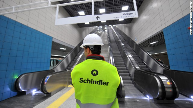 A worker stands next to escalators Monday at the Uskudar Marmaray station in Istanbul. The rail system is expected to have a capacity of 1.5 million people a day, connecting Europe and Asia in about four minutes.