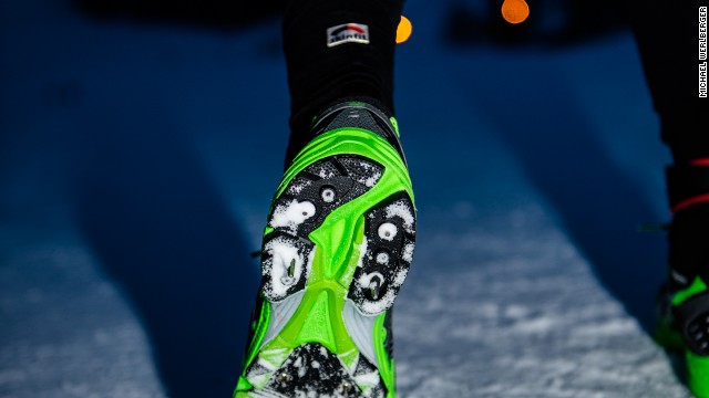 Most competitors wear spikes due to the icy conditions underfoot for the duration of the course. Others prefer to use cross-country skis.