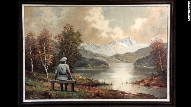 """The Banality of the Banality of Evil,"" a work by the British street artist Banksy, actually started out as a thrift store painting in New York City. Once altered by Banksy, who inserted an image of a Nazi officer sitting on a bench, it was re-donated to the store Tuesday, October 29, according to the artist's site."