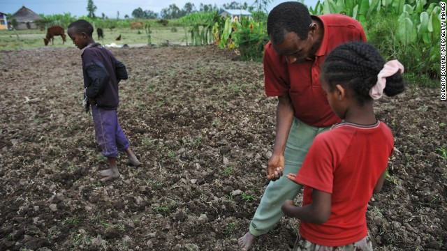 A farmer and his children plant a field with bean seeds and fertilizer in southern Ethiopia in 2008, a year after severe floods destroyed most of the food crop. Ethiopia is the country 10th most vulnerable to climate change effects, according to a report by Maplecroft.