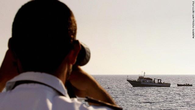 (File) An Italian coast guard officer checks a the Mediterranean.