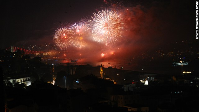 Fireworks explode above the Bosphorus Strait in Istanbul, Turkey, on Wednesday, October 29, during the anniversary of the declaration of the Turkish Republic. Turkey formally opened the world's first sea tunnel connecting two continents. The 8.5-mile long tunnel linking Istanbul's European and Asian sides includes an immersed tube tunnel which officials say is the world's deepest, at nearly 200 feet below the sea level.