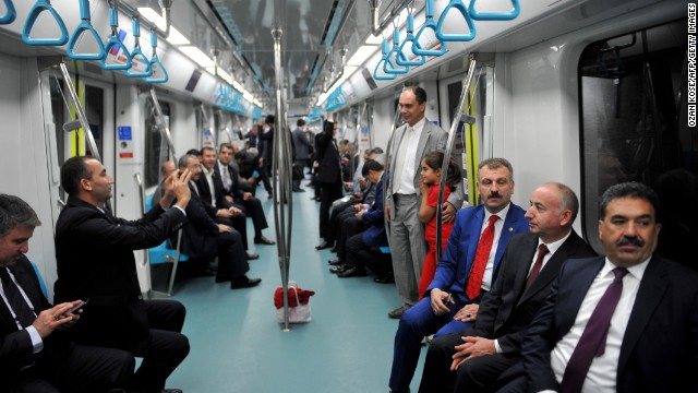 People travel from the Uskudar station to the Yenikapi station on the day of the tunnel's inauguration.