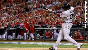 David Ortiz of the Boston Red Sox hits a double, scoring Dustin Pedroia, in the first inning against the St. Louis Cardinals during Game Five of the 2013 World Series.