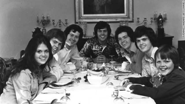 "As Sly and the Family Stone sang, the '70s really were a family affair. Following the monstrous popularity of The Jackson 5, another musical family climbed to pop stardom: The Osmonds. In the early '70s, the group -- consisting of brothers (from left) Merrill, Wayne, Alan, Jay and Donny, seen here with brother Jimmy, right, and sister Marie, left -- transitioned from their barbershop harmonies and variety shows to teen idol status with songs like ""One Bad Apple."" Eventually, Marie and Jimmy got in on the act, too."