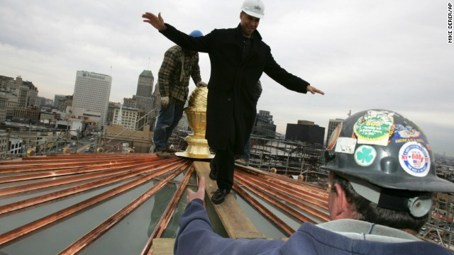 Booker walks on the newly refurbished City Hall dome in Newark in November 2006.