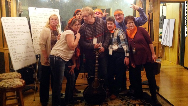 Parlor Productions offers corporate team-building events to some of the few nonmusical professionals in the city. Here a teams writes a company jingle with songwriter Brian White.