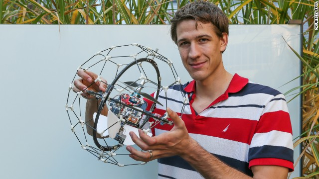 The futuristic, floating ball features a protective frame, allowing it to bounce off surfaces without damaging its in-built camera -- pictured here with co-creator Adrien Briod of the Swiss Federal Institute of Technology.