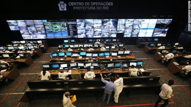 Workers gather in the Rio de Janeiro Operations Center which gathers data from 30 city agencies. According to deputy sports minister, Luis Fernandes, projects such as these will vastly improve the efficiency of cities like Rio.