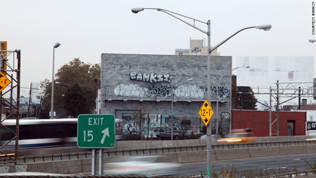 "A set of balloons that read ""BANKSY!"" tied to the side of a warehouse could be seen off the Long Island Expressway in Queens on Thursday, October 31. Banksy artwork appeared all over New York in October."