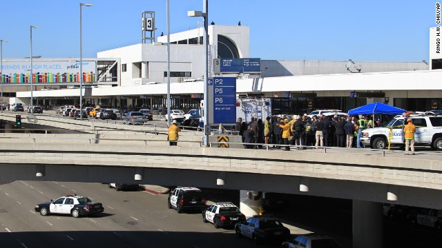Police officers and emergency response officials meet outside Terminal 3 at Los Angeles International Airport after <a href='http://www.cnn.com/2013/11/01/us/lax-gunfire/index.html'>gunshots were reported</a> inside the terminal on November 1.