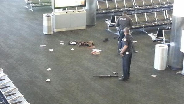 "This photo, from Terminal 3, shows what appears to be a weapon on the ground. Police said a man ""pulled an assault rifle out of a bag and began to open fire"" Friday, killing one person and injuring others before being shot and taken into custody."