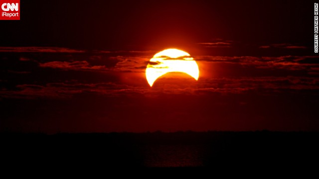 A partial eclipse, part of a rare hybrid solar eclipse, was visible from parts of the United States and other parts of the world on Sunday.
