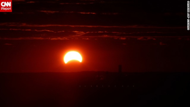 "<a href='http://ireport.cnn.com/docs/DOC-1056088'>Jeff Raybould </a>took advantage of his apartment view early in the morning and photographed the eclipse. ""I've never seen a solar eclipse. ... I'd love to observe a total eclipse at some point,"" he said."