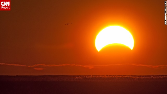 While photographing migrating waterfowl at Delaware's Bombay Hook National Wildlife Refuge, <a href='http://ireport.cnn.com/docs/DOC-1056317'>Charlie Long</a> captured the eclipse early Sunday morning.