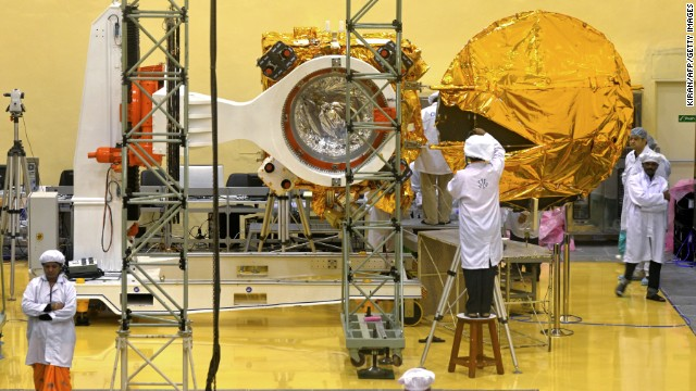 Scientists and engineers work on the Mars Orbiter vehicle at the Indian Space Research Organisation's (ISRO) satellite centre in Bangalore on September 11, 2013.