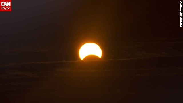 "When Luis Figueroa tried to photograph the eclipse from his home in New York City, he discovered the sun was too bright. ""So I added my homemade solar filter to [my camera] lens. When I looked through the view finder I was amazed,"" he said."