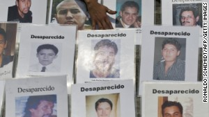 Some of the dozens of portraits of people missing in Mexico\'s drug war are displayed during a recent protest in Mexico City.\n