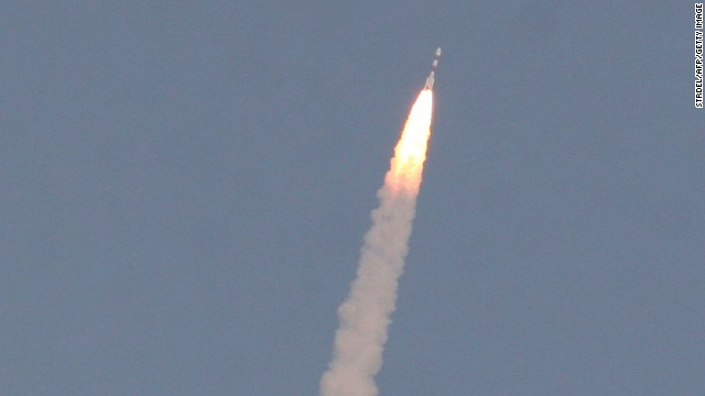 The PSLV-C25 launch vehicle, carrying the Mars Orbiter probe as its payload, lifts off on November 5, 2013.