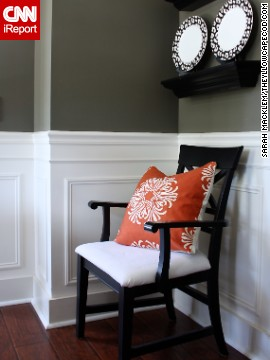 A carrot-colored pillow adds a drop of sunshine, and comfort, to a chair.