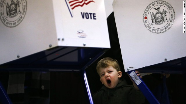 A boy yawns while waiting for his father to finish voting in Brooklyn.