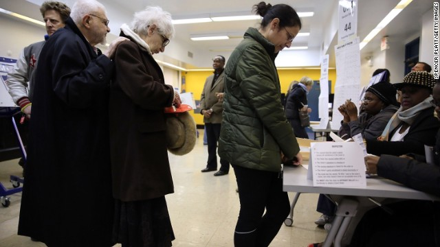 People stand in line to vote in Brooklyn.