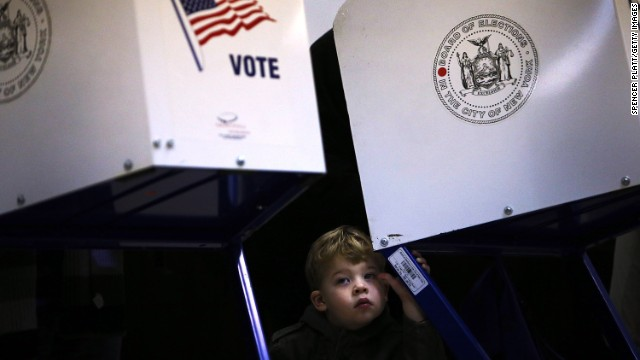 Tobias Nichols, 2, waits for his father, Dan Nichols, to vote in Brooklyn.