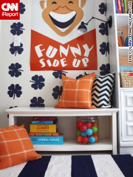 <a href='http://www.emilyaclark.com/' target='_blank'>Blogger Emily Clark</a> of Charlotte, North Carolina, used this orange-red print to play off of the cool navy and winter white on her walls.