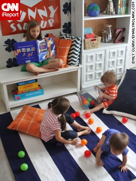 "<a href='http://www.emilyaclark.com/' target='_blank'>Clark</a> decorated this bright space with orange accents to be kid friendly. ""I wanted it to be a spot that all five of our children could use for reading, playing or just hanging out.""<!-- --> </br> <!-- --> </br>"