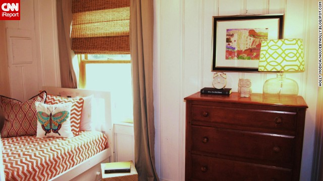 """Connecticut <a href='http://housebyholly.blogspot.com/' target='_blank'>blogger Holly Modica</a> couldn't resist the pattern of this orange and white quilt when she was shopping: """"I was a little reluctant to make the purchase, but after remembering I wanted this house to be fresh and full of personality, I bit the bullet."""""""